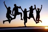 10571978-group-of-happy-young-people-jumping-at-the-beach-on-beautiful-summer-sunset