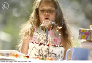 girl_blowing_out_birthday_candles_42-15470187
